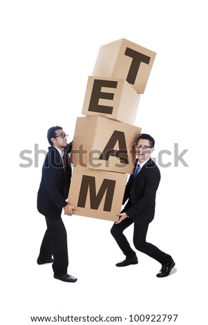 Business people working together in a team carrying card boxes isolated on white