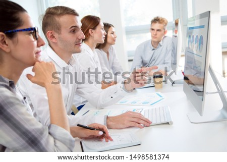 Business people working together in the modern office #1498581374