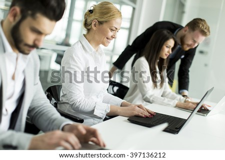 Business people working together in the office - Shutterstock ID 397136212