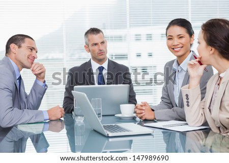 Business people working together over coffee in bright office