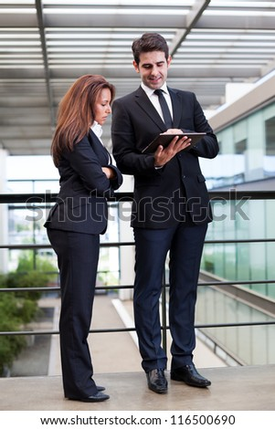 Business people working with electronic tablet at modern office bulding
