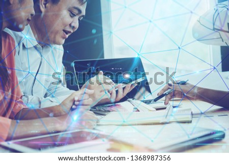 Business peoples using smart devices with digital visual effect as connection network for their business success #1368987356