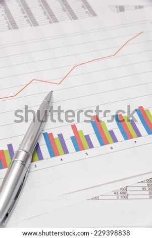 Business performance analysis. Business Graphs and pen.