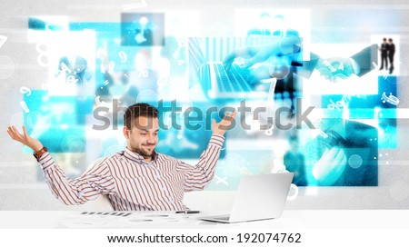 Business person at desk with modern blue tech images at background