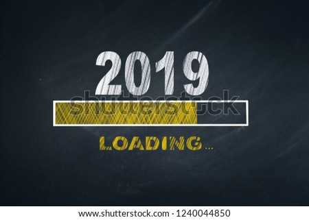Business Person Drawing Loading 2019 on Blackboard  #1240044850