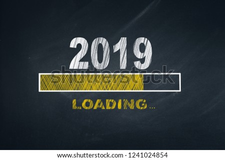 Business Person Drawing Loading 2019 on Blackboard  #1241024854
