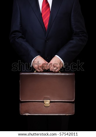 business person holding a briefcase - stock photo