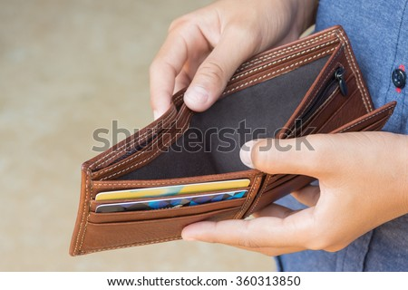 business person holding an empty wallet (no money) Stock photo ©