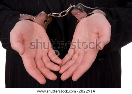Business person in handcuffs isolated over white