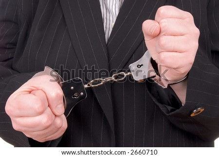 Business person in suit in handcuffs