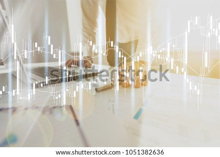 Business person investigating infographs #1051382636