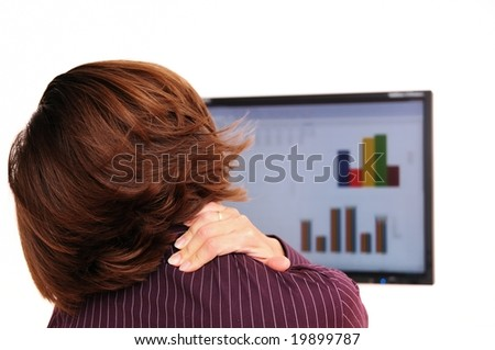 Business person with neck pain behind computer monitor