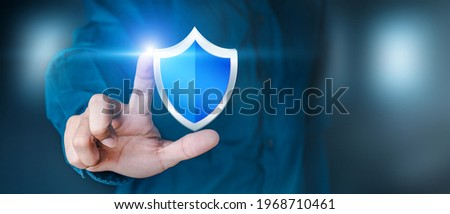 Business personnel touch the shield icon to safeguard data or networks, and virus security is ensured. Insurance and data protection Information security against viruses, business security principles