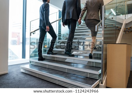 Business persons going up the stairs.
