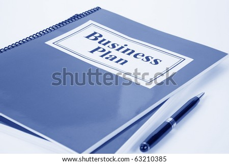 Business Plan and pen close up
