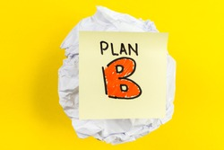 Business plan B message on crumpled paper ball and yellow background