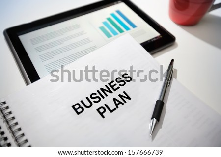 Business plan strategy with touchscreen presentation.