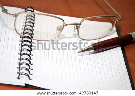 Business planner, glasses an pen