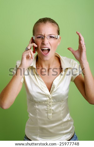 business portrait of a young screaming woman is calling with a mobilephone