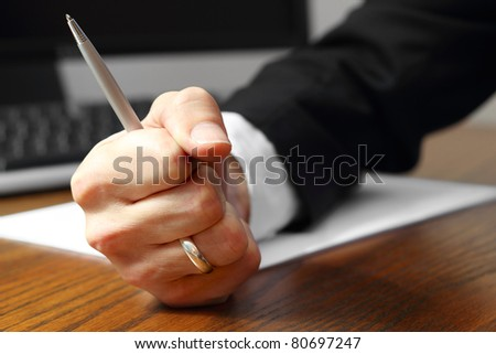 Business power, determination and strength, decisiveness by fist gesture (decision)