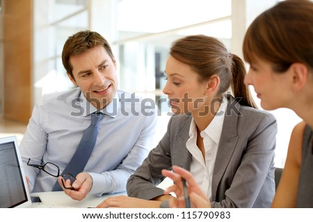 Business presentation around table