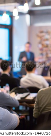 Business presentation being given by tech executive. Corporate seminar with expert speaker presenting to people. Man giving speech during lecture. Leadership training coach in workshop.  #1440726920