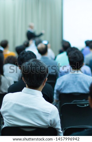 Business presentation being given by tech executive. Corporate seminar with expert speaker presenting to people. Man giving speech during lecture. Leadership training coach in workshop.  #1457996942