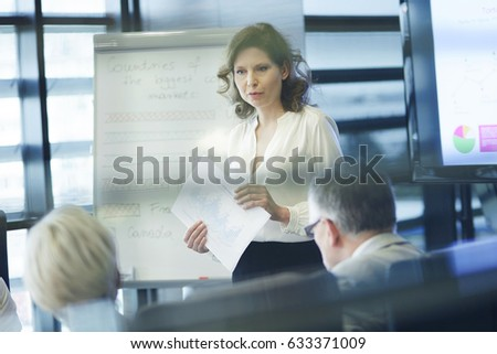 Business presentation by female coworker 