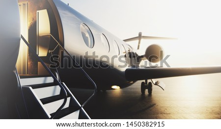 Business private jet airplane parked at terminal. Luxury tourism and business travel transportation concept. Closeup. 3d rendering Photo stock ©