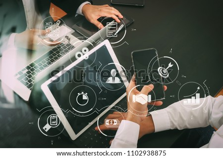 Business process management with workflow automation diagram and gears in virtual flowchart.co working team meeting concept,businessman using smart phone and digital tablet and laptop computer. #1102938875