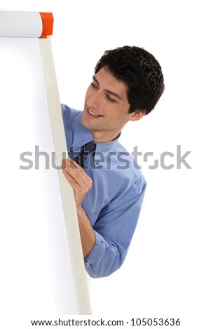 Business professional looking at a flip chart