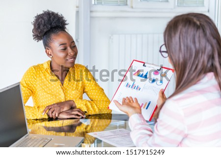 Business professionals. Two young confident business women analyzing data using computer while spending time in the office Idea presentation, analyze plans.