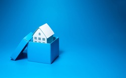 Business property and real estate concepts with white model house inside small box over all on pastel color background.