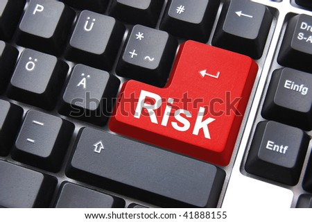 business risk management with computer keyboard enter button - stock photo