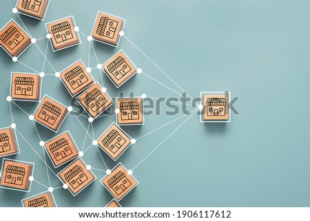 Business sale growth and expand shop franchise concept, Store illustration print screen on wooden cube block connection link with others shop and supermarket.