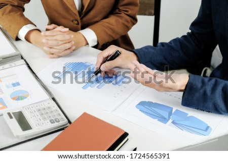 Business sales consultant discussing in data documents at modern office.