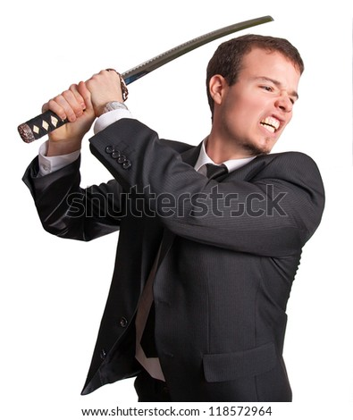 Business samurai - Young suited man attack with a katana