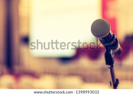 Business seminar, speech presentation, town hall meeting event in lecture hall or conference convention room in corporate or community event for host or public hearing with microphone voice speaker