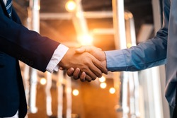 Business shaking hands, finishing up meeting. Successful businessmen handshaking after good deal.