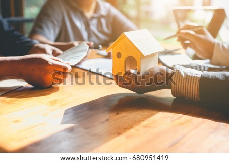 Business Signing a Contract Buy - sell house.