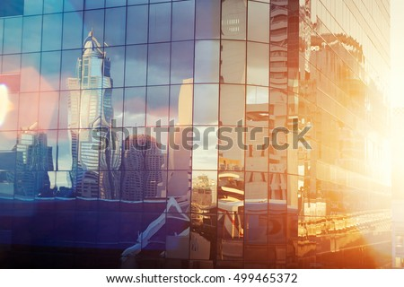Business skyscrapers at sunset reflected in windows, Bangkok, Thailand. Vintage filtered. #499465372
