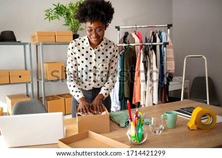 Business Start up SME concept. Young startup entrepreneur small business owner working at home, packaging and delivery situation. Women, owener of small business packing product in boxes
