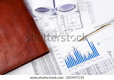 business still life, charts, blueprints and notepad