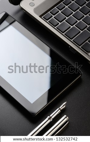 Business still life: laptop, tablet, fountain pen.