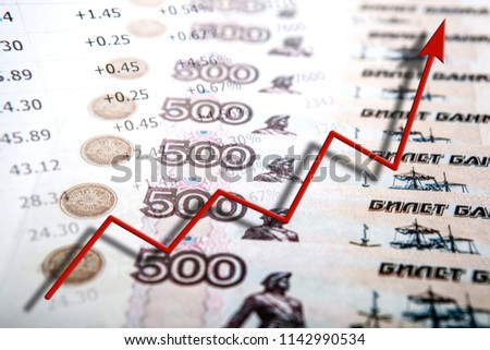 business still life of money bills and figures and a graph of progress close up