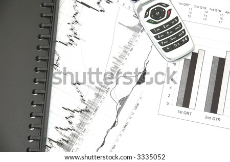 Business still life with charts showing performance over quarterly financial periods and stock prices.