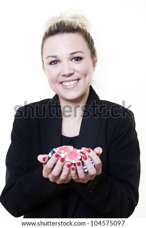 business style woman holding out a handful of poker chips looking very happy