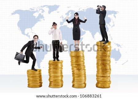 Business success concept: Businessmen and businesswoman standing on stacks of golden coins