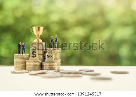 Business success / deal achievement, winner concept : Golden trophy, businessman CEO CFO or CMO, US dollar money bag, tax bag on rows of rising coins, depicts level of toughness in business dialogue