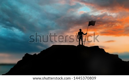 business, success, leadership, achievement and people concept - silhouette of businessman with flag on mountain top over sunset background